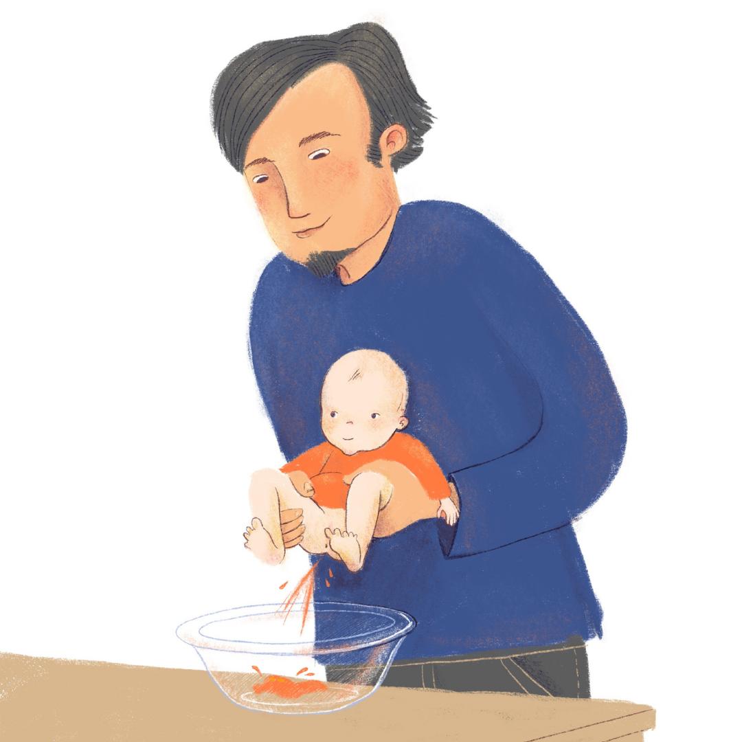 Vater hält Baby über Schüssel ab